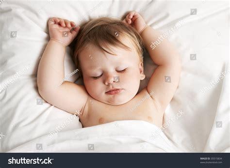 baby sleeping in bed baby sleeping in bed stock photo 35515834 shutterstock