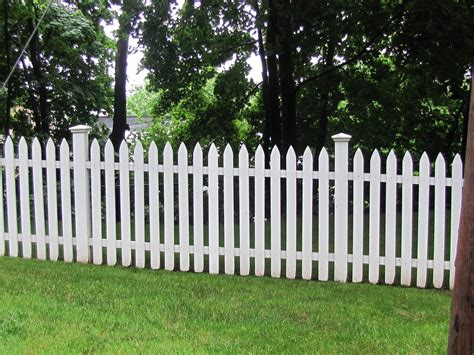 backyard garden fence backyard garden covered white fence leafy trees