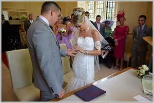 Rings during their marriage ceremony at newbury register office