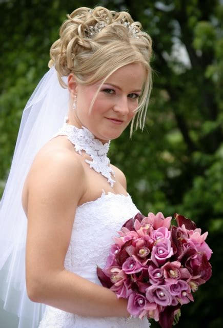 classic bride curly hairstyle  blond  pearl hair
