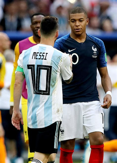 kylian mbappe on messi kylian mbappe of france consoles lionel messi of argentina