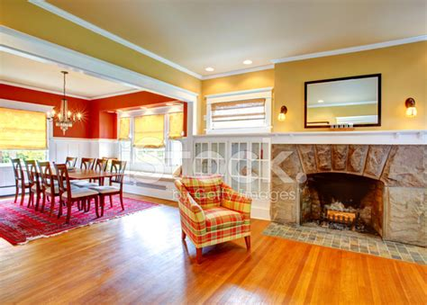 red and yellow living room house living room and contrast red dining area stock