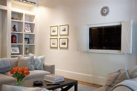 hiding tv in living room home blends contemporary style with country elements melanie millner hgtv