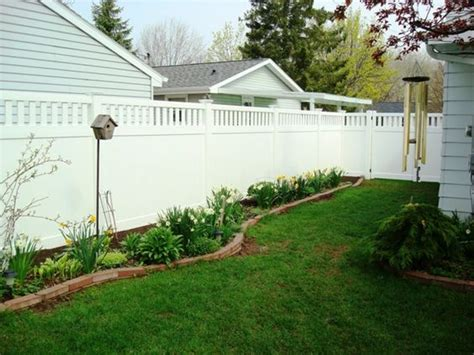 backyard landscaping ideas along fence landscaping along white privacy fence fence makes a beautiful backdrop for this