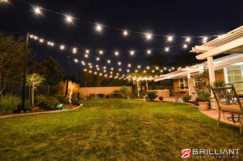 backyard wedding reception amber uplights market lights