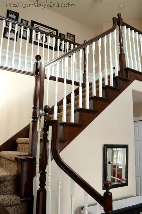 dark wood banister diy staircase makeover with stain and paint