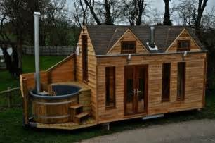 Tiny House New England man designs and builds mobile hot tub tiny house
