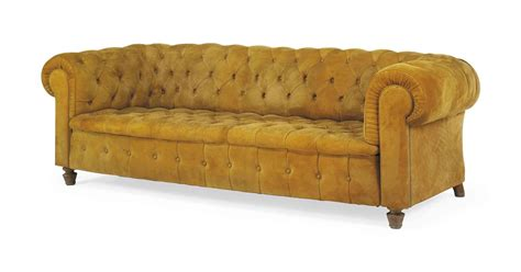 a buttoned suede chesterfield sofa by carlos