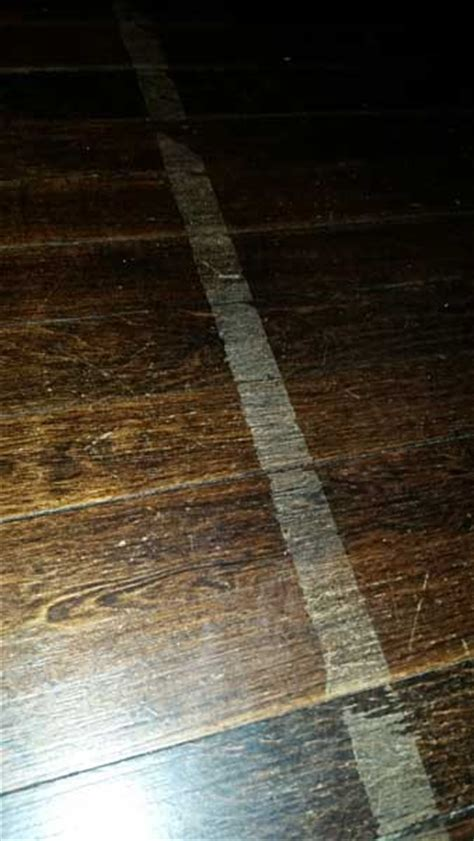 Don't use tape on wood floors   Mr. Floor Chicago IL