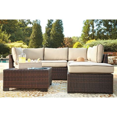 sectional sofa drink signature design by ashley loughran outdoor sectional set