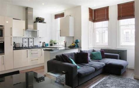 open plan kitchen  living room  long sofa