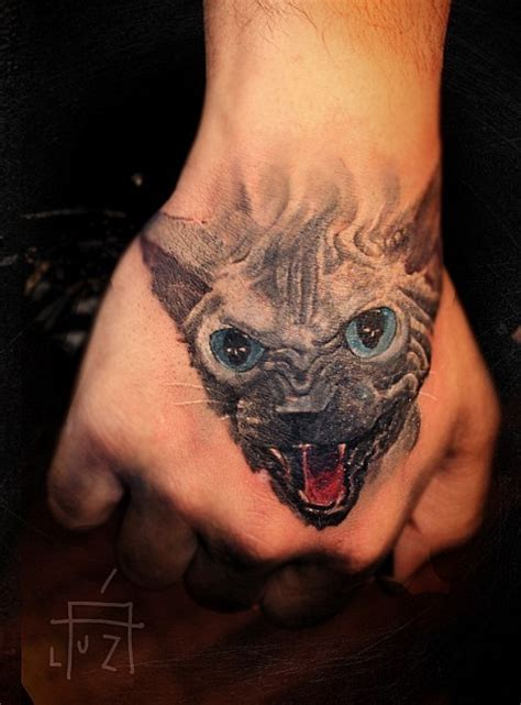 cat tattoo in hand great cat tattoos pictures tattooimages biz