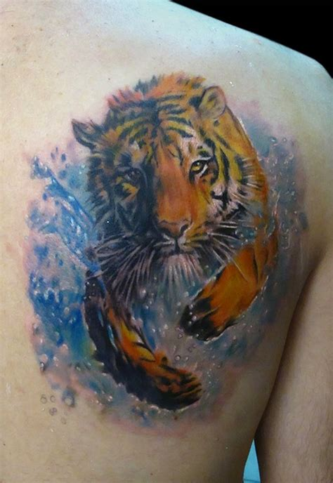 watercolor tiger tattoo of running in river tiger by bhbettie