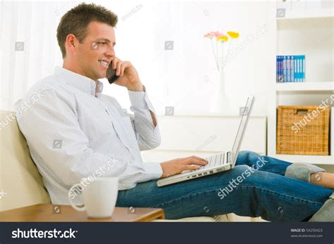 working at home casual businessman working at home sitting on using
