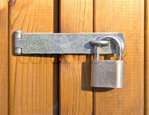 Padlock For Door by Padlock Securing Room With Wooden Doors Stock Photo