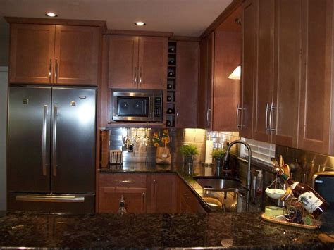 dark maple cabinets kitchen contemporary with backsplash remodeled kitchen with stainless steel backsplash and