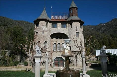 House With Moat by Castle With Turrets And Drawbridge On The Market For