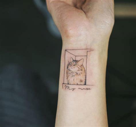 box tattoo small cat inside a box on the right inner wrist