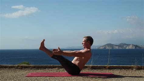 boat pose with block yoga poses for a healthy spine by foodnhealth org