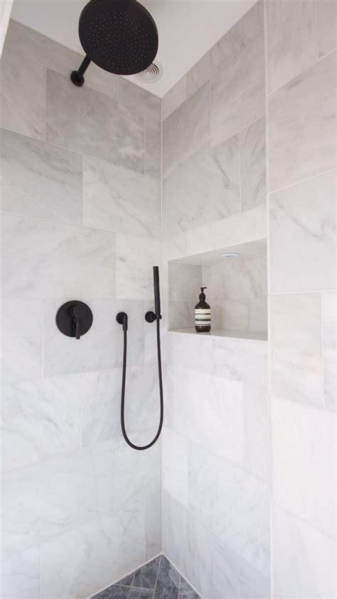white stone tile bathroom 25 best ideas about black shower on pinterest concrete