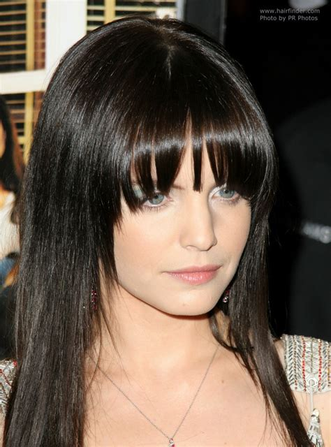 tapered bangs hairstyles mena suvari s sleek and face framing long black hair with