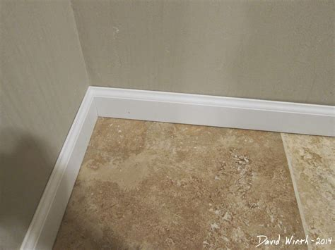 how to install baseboard trim in bathroom baseboard trim and marble tile flooring master bathroom