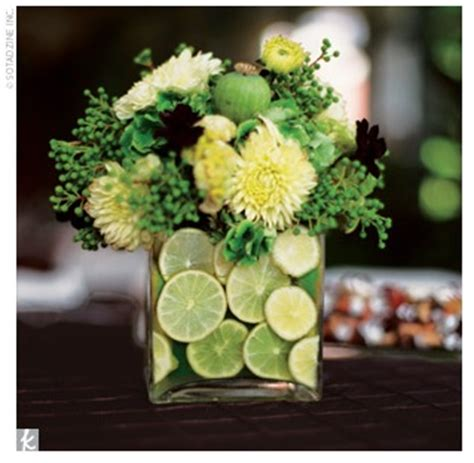 Sliced Lime And Flowers In Glass Vase Centerpieces Lime Green Centerpieces