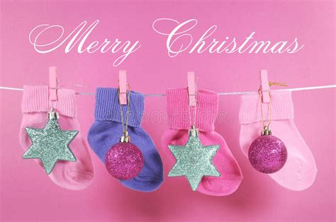 festive childrens baby stockings  merry christmas sample text stock photo image