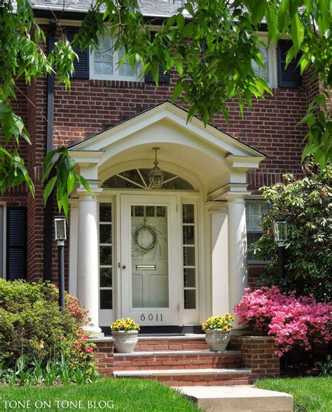 portico on colonial house tone on tone storm doors ideas and inspirations