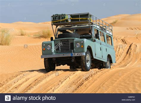 land rover africa africa tunisia nr tembaine desert tourists driving