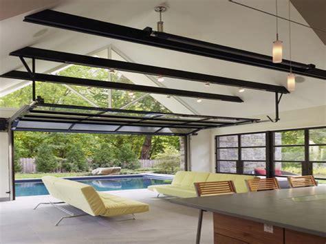 Exterior folding doors, pool house with garage door luxury