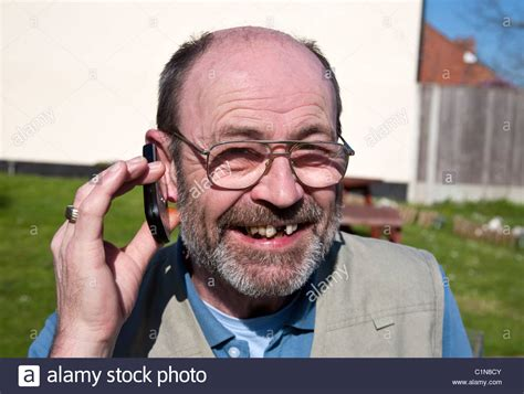 60 year old men with beards 60 year old man with beard laughing using mobile phone