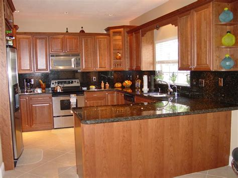 home design cabinet granite reviews top uba tuba granite with dark cabinets on furniture