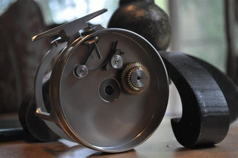 Handmade Fly Reels - click and pawl reel drowning worms