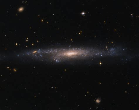 hubble sees galaxy hiding   night sky