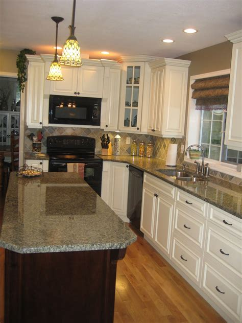 white kitchen cabinets with black island kitchen give breathtaking design of the kitchen by