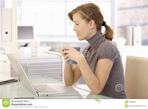 Office Worker At Desk Attractive Office Worker Tea At Desk Stock Image Image Of Look Computer 18848655