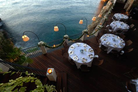 cave resturuant side of a cliff italy magnificent restaurant built into a cave in a cliff on the italian coast
