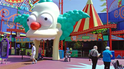 theme park owned by a television clown on the simpsons ranking universal studios hollywood s top rides