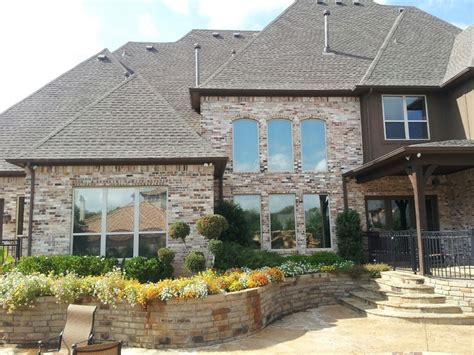 mirror tint for house windows llumar dr 15 window tint on this house lonestarwindowtinting com commercial
