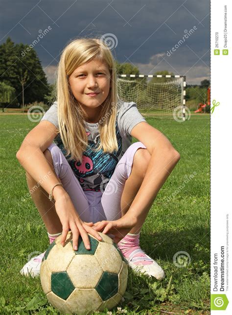 11yr girl girl sitting on a football field stock photo image of