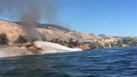 guy in cigarette boat helps put out grass fire wow video - Cigarette Boat Puts Out Fire In Kamloops