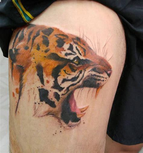 animal tattoo on leg tiger thigh tattoo by octaviano http tattooideas247 com