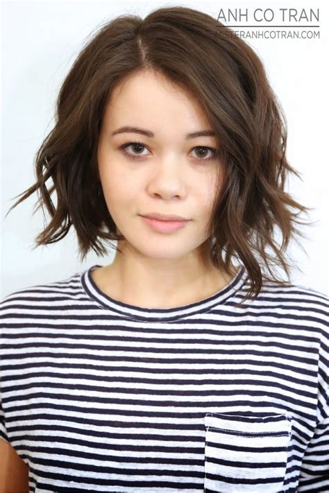 asymmetrical bob with a wave line across the front and one asymmetrical a line haircut haircut ideas
