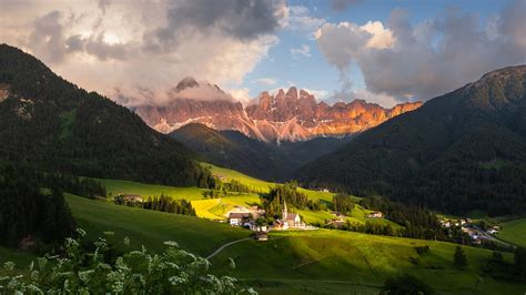 dolomites mountains village clouds italy