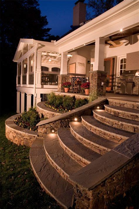 wrap around porch steps to door covered deck and open tapered stone steps to open porch notice the tiered