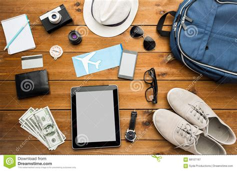 travel gadgets for summer vacations photos architectural close up of gadgets and traveler personal stuff stock