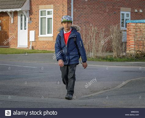 school children walking home stock photos