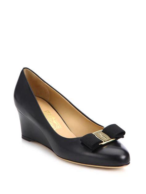 ferragamo mirabel bow leather wedge pumps in black lyst