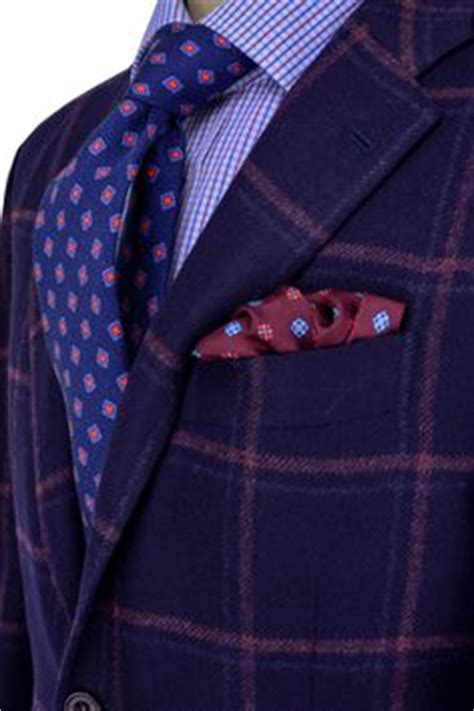 Foppish Elegance Menswear by Isaia Blue And Navy Plaid Suit Apparel S S